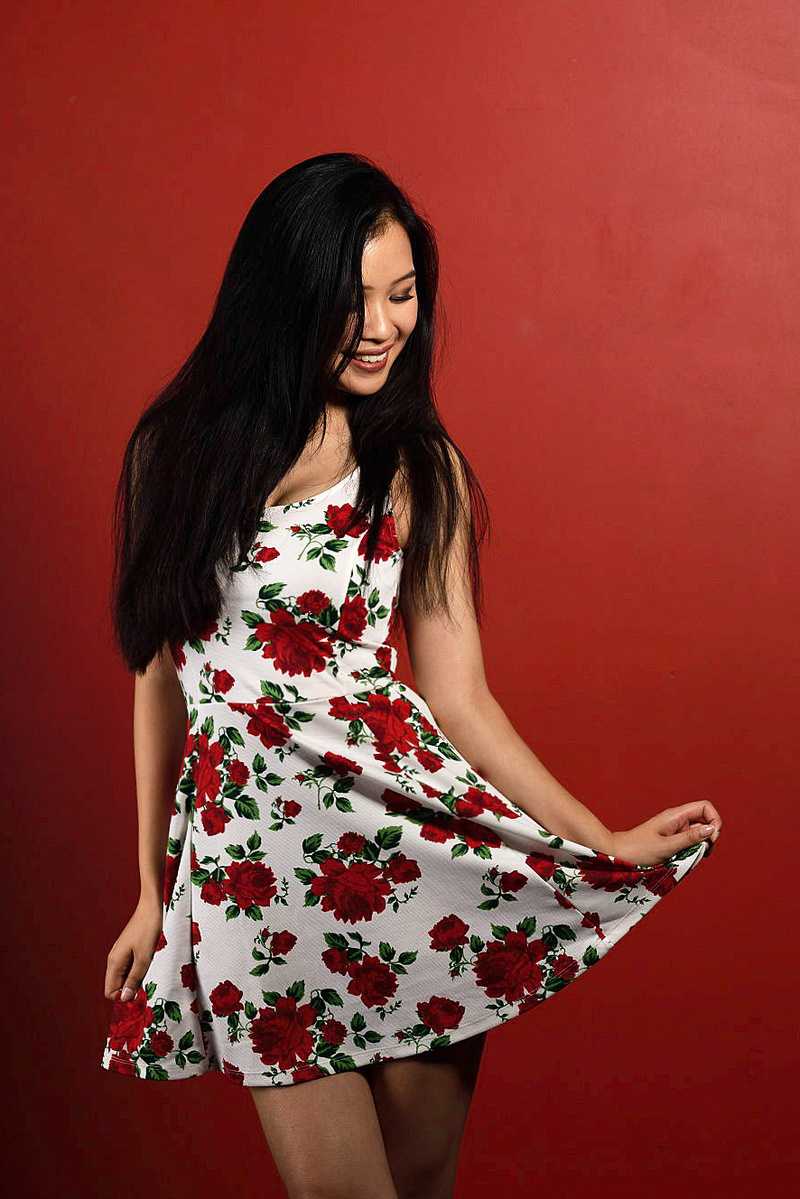 pretty asian american model in red roses dress
