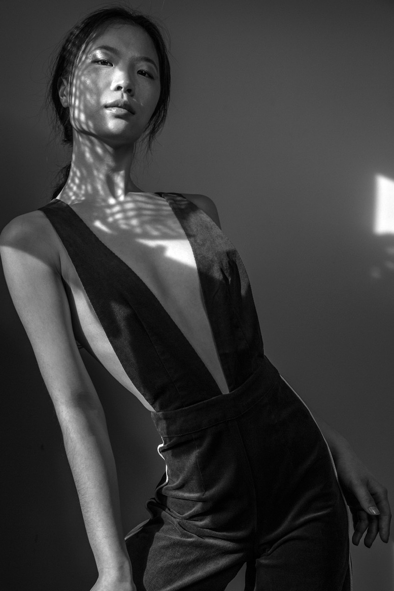 black and white image of the slim, asian, chinese model from new york