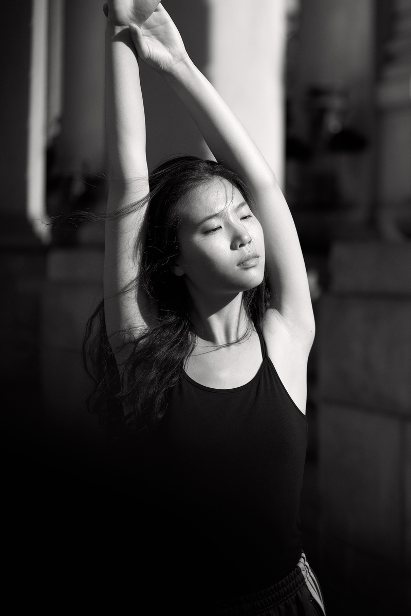 sexy asian babe stretching in black and white photo